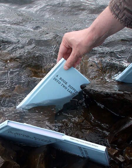 Books being dipped in Meldon Reservoir (2015)